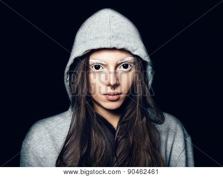 Portrait Of A Sensual Young Woman With Black Eyes And White Eyebrows. Hipster Girl In Grey Hoodie