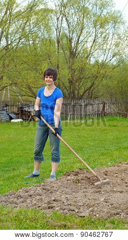 Nice woman working with a rake