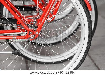 Parked Red Street Bicycles For Rent, Rear Wheels