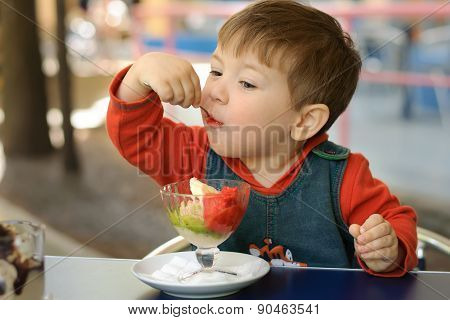 Little Boy In A Red Hoodie Eats Ice Cream