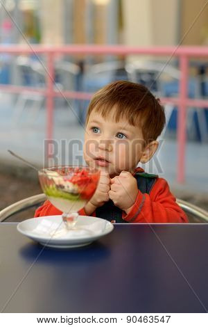 Little Boy Showing Ice Cream Is Cold