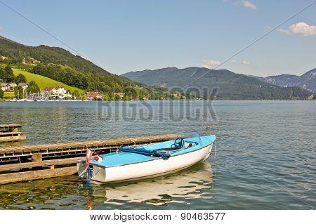 Boat Near Pier On Alpine Lake