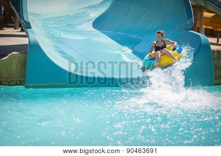 Beautiful Girl Pulls Off The Slides At Water Park