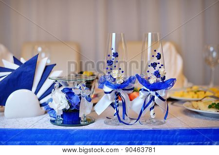 Two Glasses And Candle On Served Celebratory Table