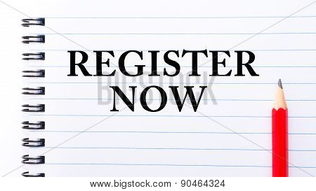 Register Now Text Written On Notebook Page