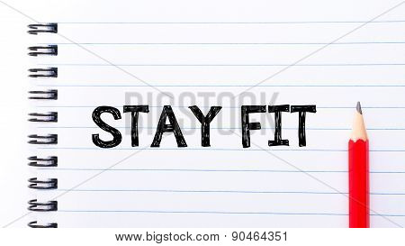 Stay Fit Text Written On Notebook Page