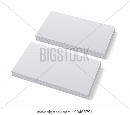 Two stacks of blank business cards on white background