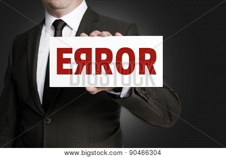 Error Sign Held By Businessman