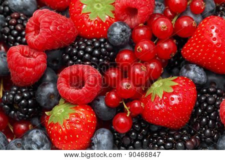Close-up View On Pile Of Different Berries
