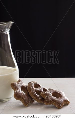 Bavarian Cookies Iced With Sugar Powder With A Jug Of Milk