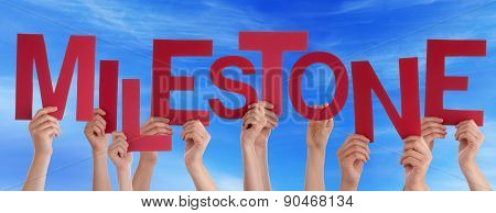 People Hands Holding Red Word Milestone Blue Sky