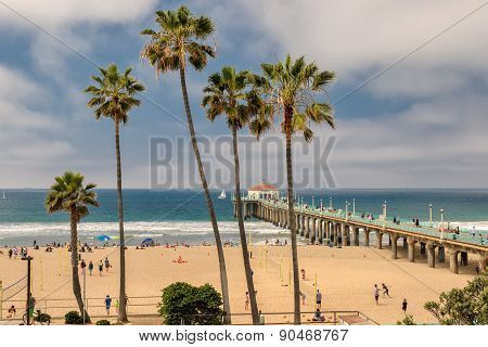 MANHATTAN BEACH, USA - MARCH 28, 2015: People enjoy beach at pier on March 28 in Manhattan Beach