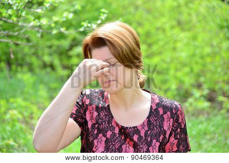 Woman With Rhinitis In  Summer Park