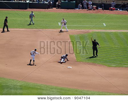 Shortstop Cliff Pennington Throws To 1St To Turn A Double Play
