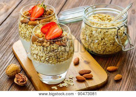Healthy Breakfast. Natural yogurt with muesli and walnut