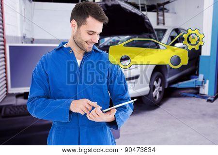 Male mechanic using digital tablet against workshop