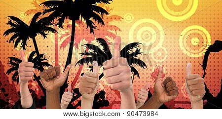 Hands showing thumbs up against digitally generated palm tree background