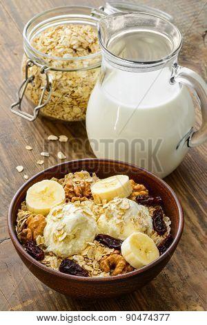 Healthy breakfast - whole grain muesli with a banana and ice cream