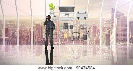 Businessman on phone against room with large window looking on city