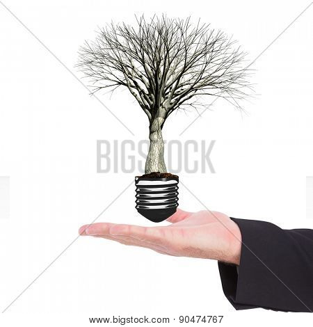 Businessman holding hand out in presentation against empty light bulb