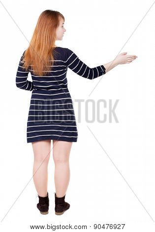 back view of woman. Young woman in vest presses down on something. Isolated over white background. Rear view people collection. backside view of person. . The guide tells