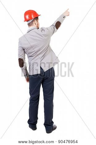 Back view pointing young men in helmet. Young guy gesture. Rear view people collection.  backside view person. isolated over white background. bearded businessman at a construction site refers to top