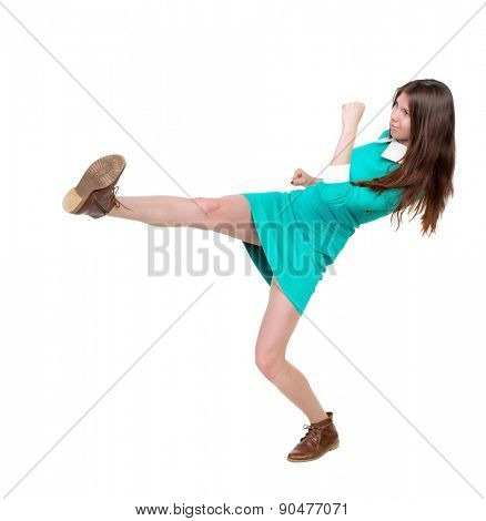 skinny woman funny fights waving his arms and legs. Isolated over white background.  Girl in leather boots strikes.