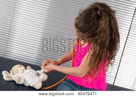 Female Doctor Examining A Young Girl In A Hospital