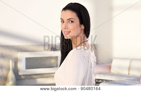 Portrait of attractive young caucasian woman at home, smiling.