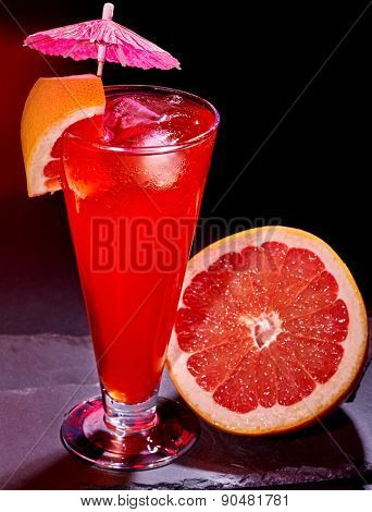 Grapefruit cocktail with umbrella  in highball glass . Cocktail card 50