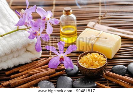 Spa setting with candle ,towel, soap with mat