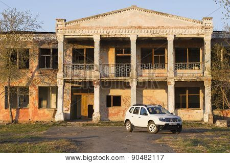 White Renault Duster near abandoned building