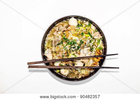 White Noodle And Soup Pork In Black Bowl With Wood Stick