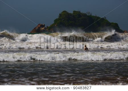 Waves on the tropical beach in the town of Weligama, Sri Lanka