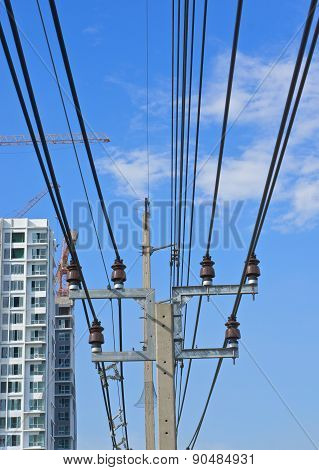 Electricity Post And Cable Line With Blue Sky