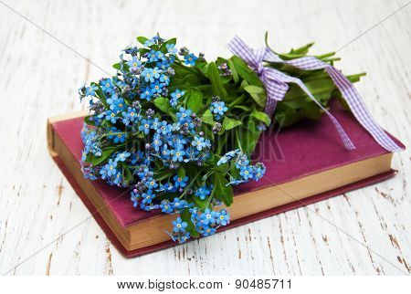 Bunch Of Forget-me-not Flowers And Old Book