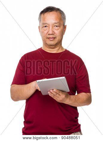 Asian man use of digital tablet