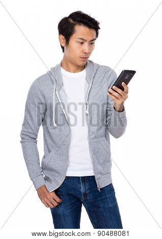 Asian man read on mobile phone