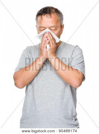 Mature man sneeze