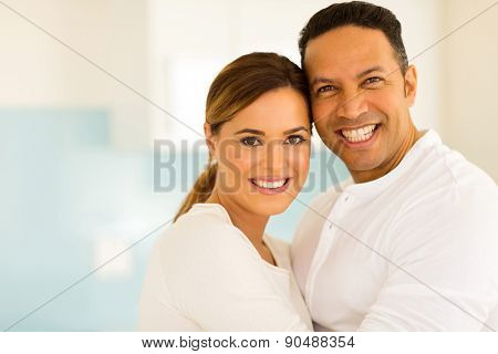 romantic mid age couple hugging indoors