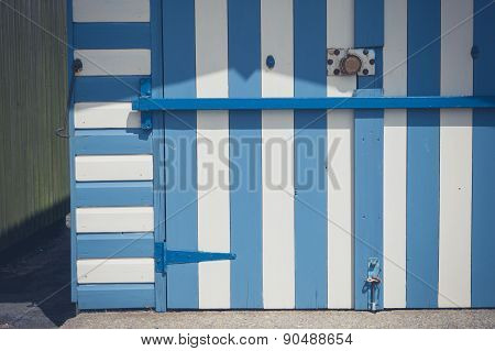 Colorful Beach Hut With Blue And Whiter Stripes