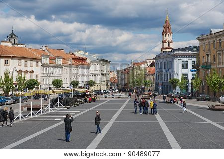 People walk by the Town Hall square in Vilnius, Lithuania.