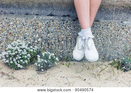 Woman Sitting On Wall By The Sea