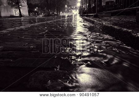 Rain water flowing on a cobblestone street in Helsinki
