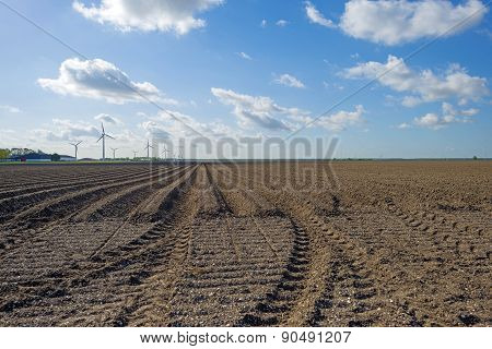 Plowed field with furrows in spring
