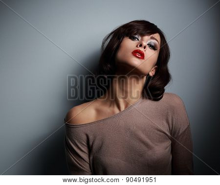 Sexy Posing Model With Short Hair Style On Dark Background