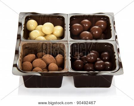 Chocolate candies in plastic container