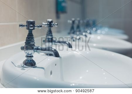 Row Of Wash Basins In A Bathroom