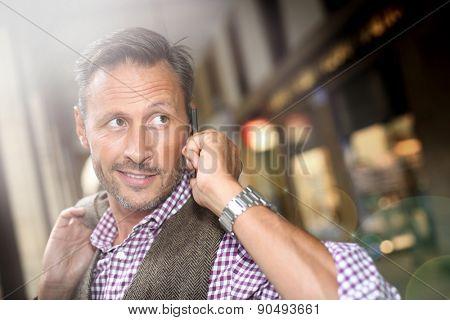 Man in shopping street talking on mobile phone