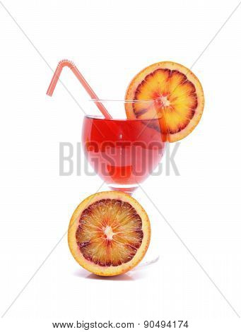Blood orange cocktail with slices of blood orange
